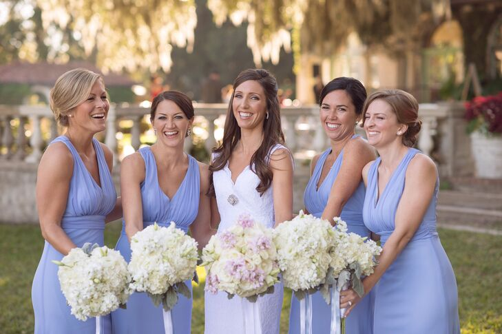 Each bridesmaid wore a floor-length sleeveless periwinkle dress with a lace detailed back.