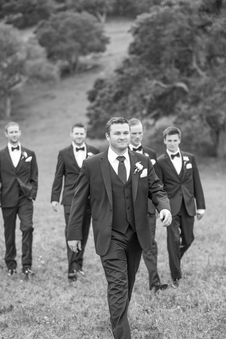 The groom and groomsmen wore Vera Wang formalwear with white flower boutonnieres.