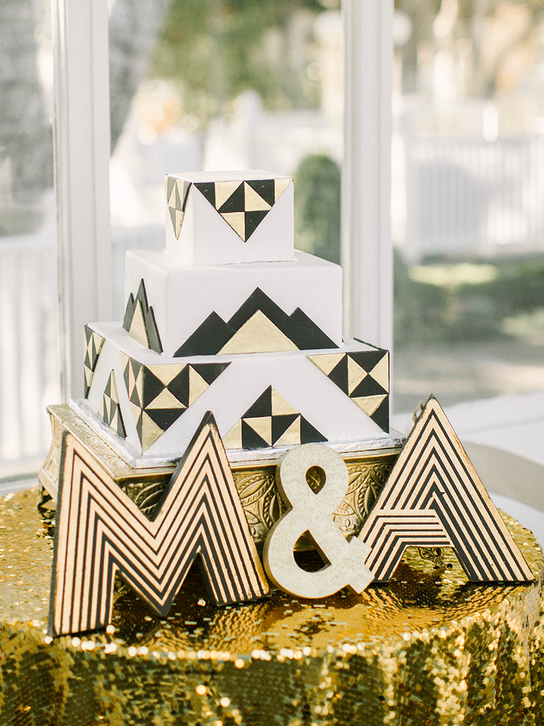 Art deco style gold and black wedding cake