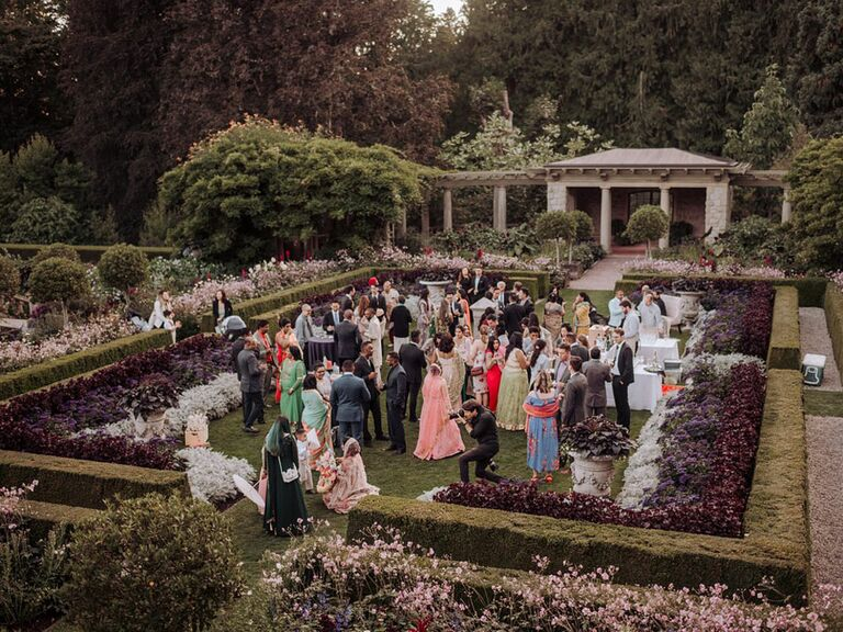 Guests mingling at outdoor whimsical garden wedding
