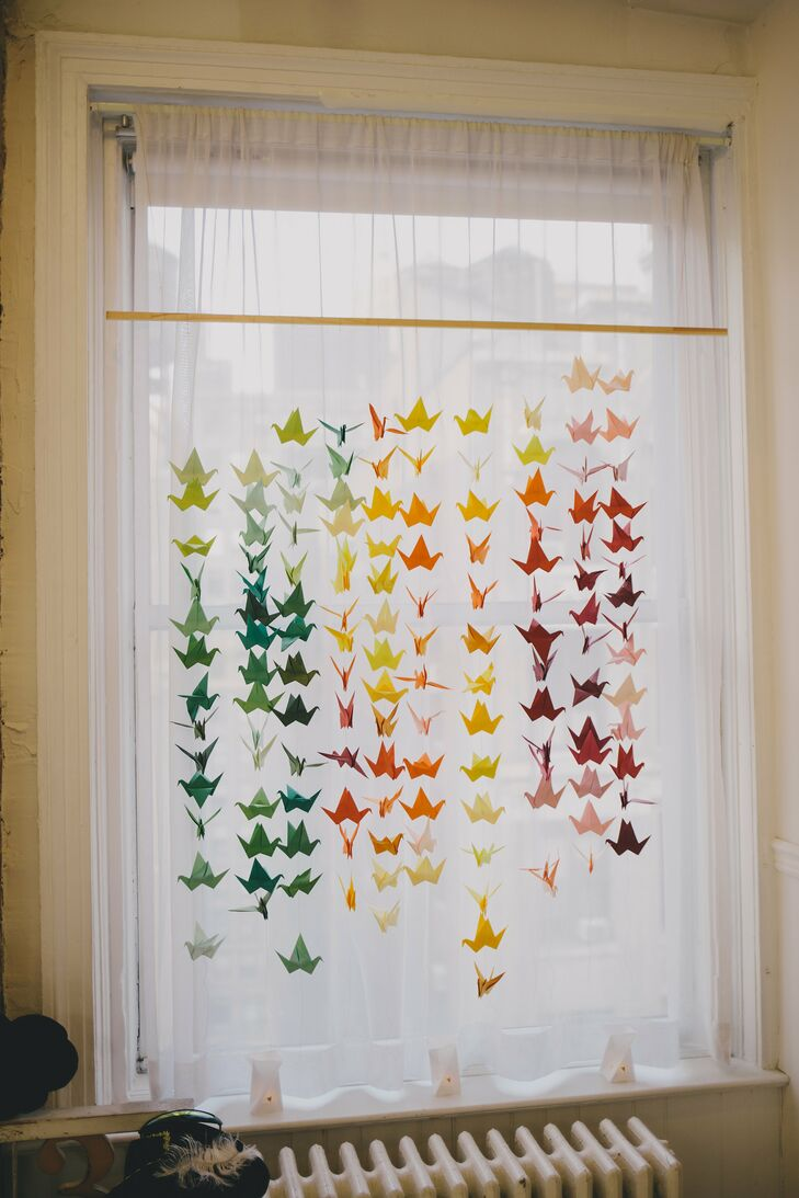 """We used the paper crane palette as an inspiration for our flowers,"" Rainne says. Did we mention that the bride made each one by hand?"