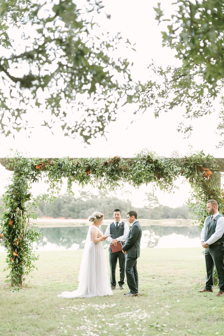 The pretty outdoor ceremony setting was enhanced through an altar wrapped in blooms, greenery and antlers.