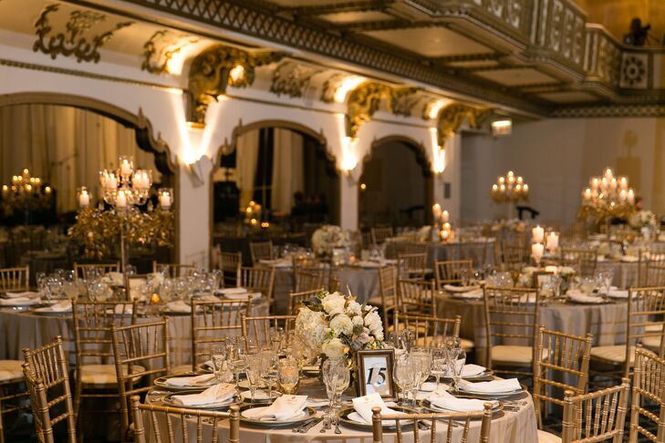 "The wedding color palette consisted of navy, gold and ivory. ""We went heavy on the candlelight in the reception space to give a very romantic and soft look,"" the bride explains."