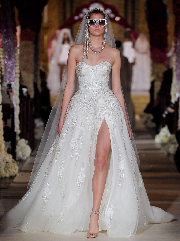 Reem Acra Spring 2020 Bridal Collection strapless embellished wedding dress with high leg slit