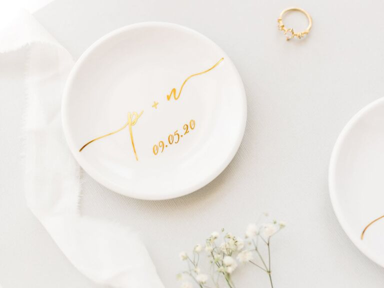 White ring dish personalized with date and initials in gold lettering
