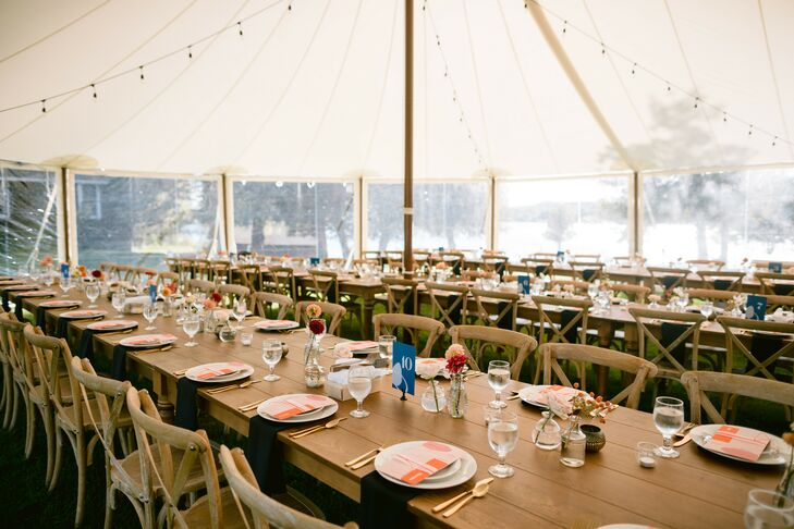Tented Reception Space with Colorful Placesettings and Farm Tables