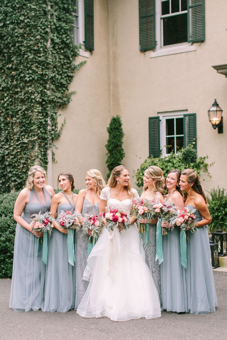 """I was into the mismatched bridesmaid look, but I still wanted cohesion,"" Stefanie says. ""I had also been in a wedding where the bride just picked a color and said choose whatever dress you want, and I found it even more stressful trying to find a dress in the color she wanted."" Knowing she wanted the dresses to be a specific shade of blue, Stefanie had the women don a convertible dress by Jenny Yoo that offered the best of both worlds. Her maids of honor wore floor-length Adrianna Papell gowns with beaded embroidery that tied in perfectly with the evening's vintage theme."