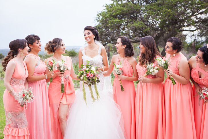The bridesmaids wore floor-length coral dresses in various styles to match  the laid- 323766978