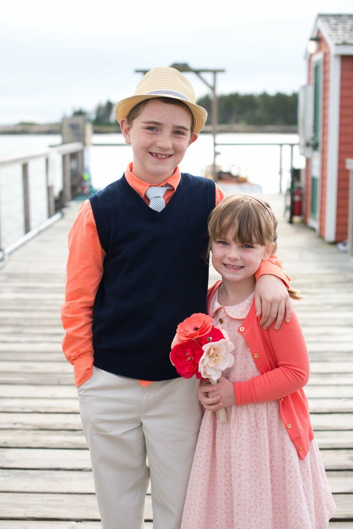 The flower girl and ring bearer wore bright shades of orange, pink and coral.