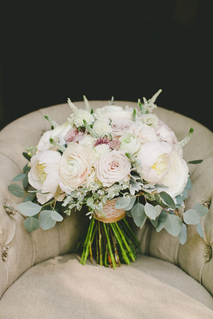 Since the nuptials had a garden-inspired theme, the bridal bouquet ended up being nothing short of beautiful. The round pastel-colored arrangement had roses, ranunculus, peonies and veronica mixed with lush green leaves.