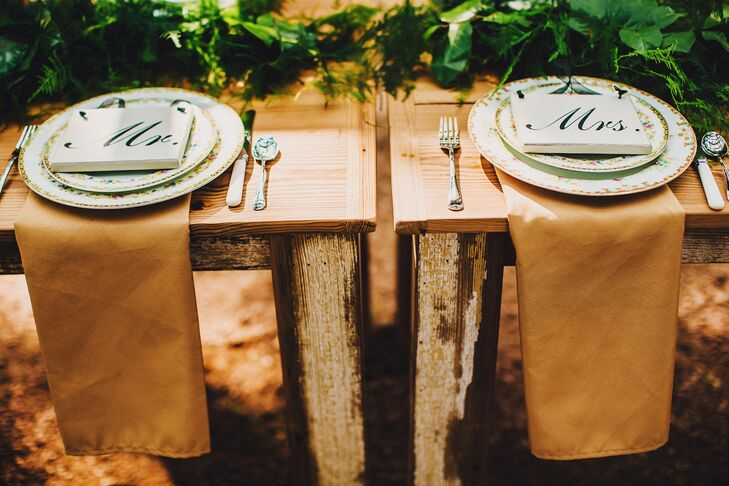 Rachel and her mother took care of the place settings for their reception. After trips to various garage sales and flea markets, they were able to hand-pick all the vintage dinnerware. The family-style tables were specifically left uncovered to play on that rustic vibe, including the sweetheart table. As for the gold napkins, each was chosen to the gold linens on their buffet table.