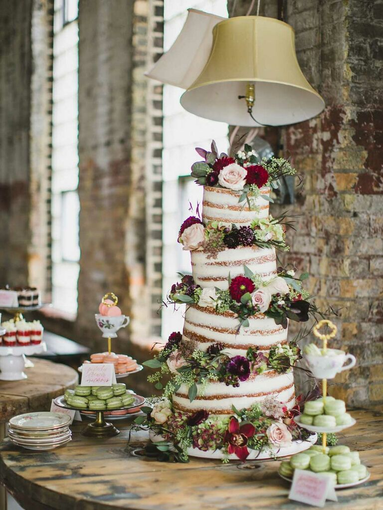 Naked cake with tilted tiers and fresh florals