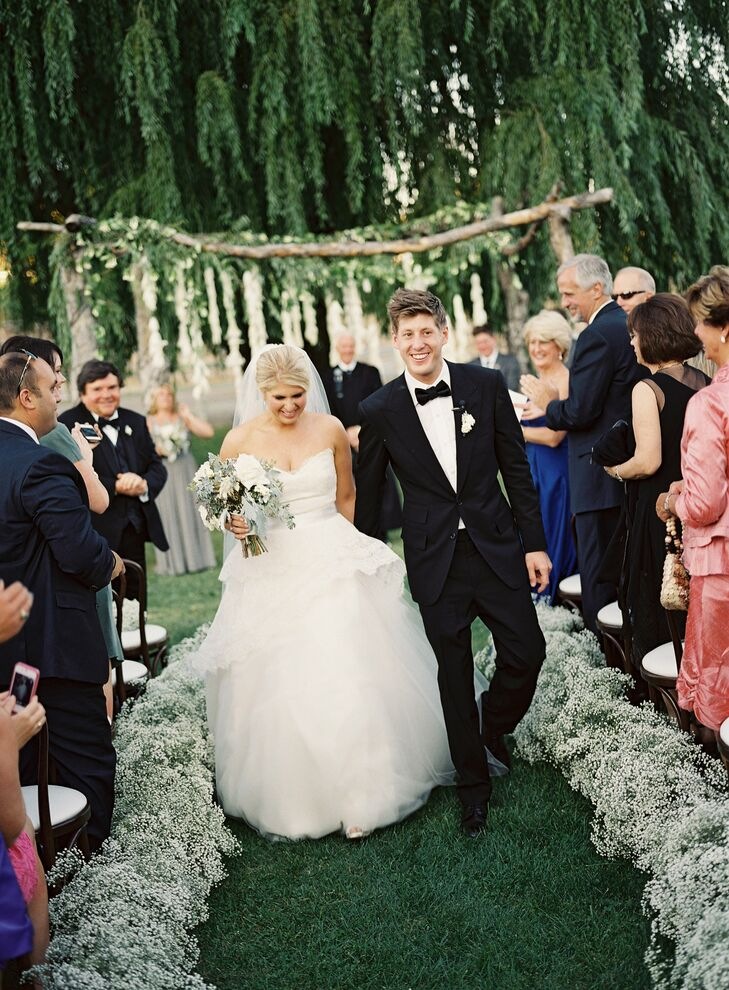 Andrew sported a perfectly tailored black Tom Ford tuxedo, while Kelly wore a Monique Lhuillier ball gown with with an asymmetrical horsehair peplum bodice and full tulle skirt.