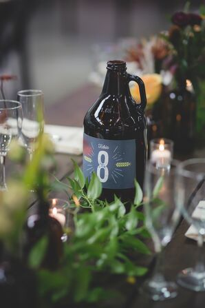 Table Numbers on Glass Growler Centerpieces