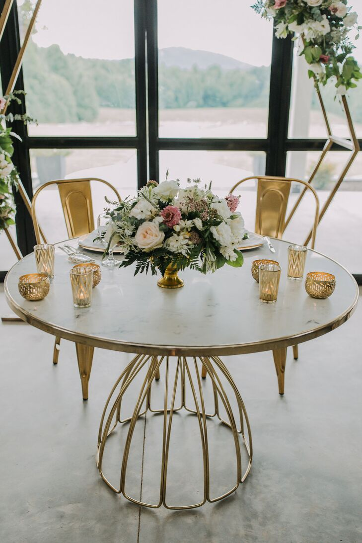Modern Sweetheart Table with Gold Chairs, Candles and Flower Arrangement