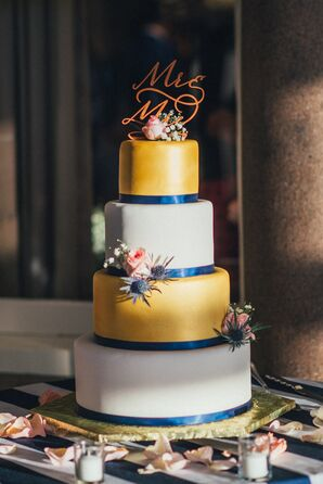 Four-Tier Gold and Navy Wedding Cake