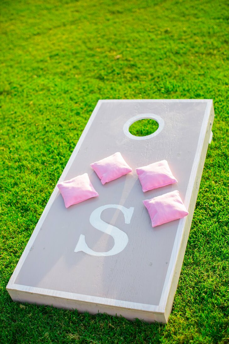 The cocktail hour included lawn games like cornhole, which guests played on a custom set complete with the couple's monogram.