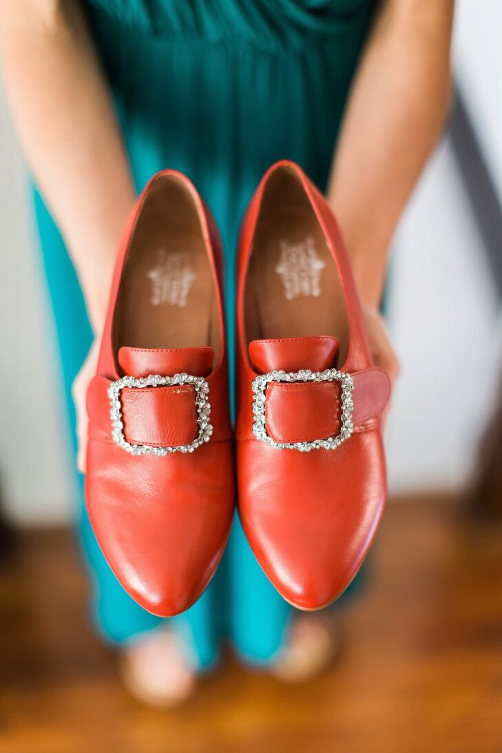 With a love for history, Patricia chose a fun pair of vintage-style shoes for her wedding. She wore scarlet red 18th-century-inspired shoes with jeweled buckles. To match the period, she even slipped on a pair of white, thigh-high stockings.