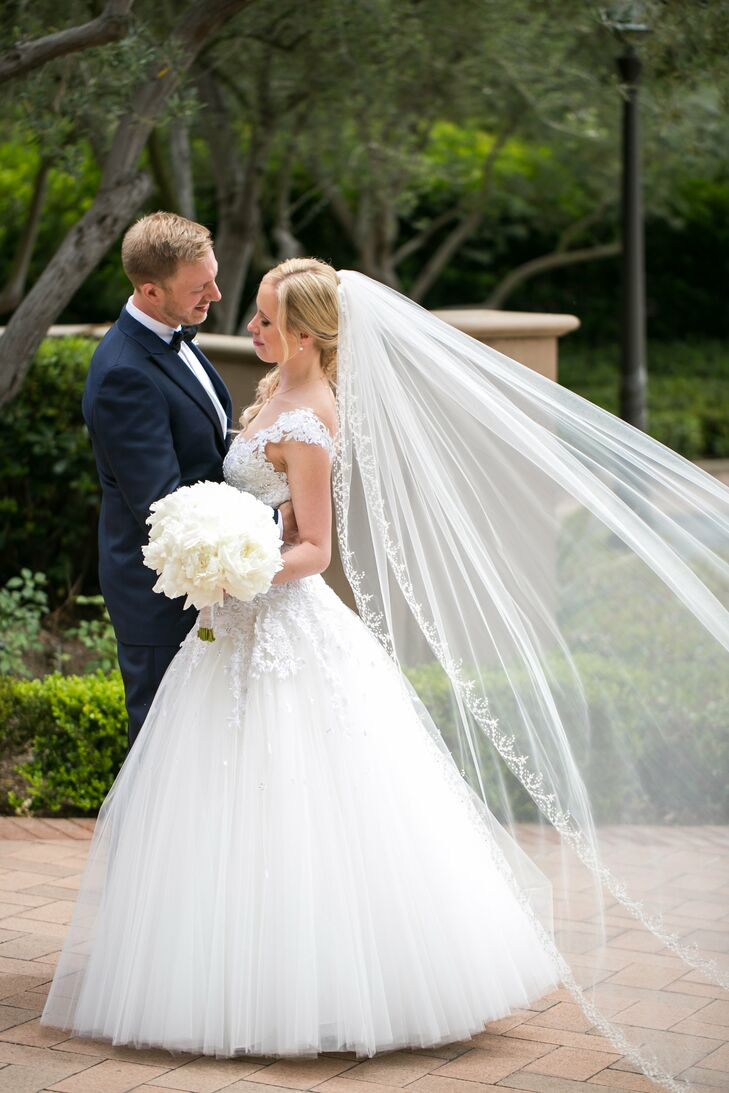 """I absolutely loved my dress, but I did have another dress to change into, which made dancing a little easier,"" Kelly says of her A-line gown. ""I thoroughly enjoyed helping Michael pick out his attire just as much. Michael wore a beautiful navy blue tuxedo from Canali."""