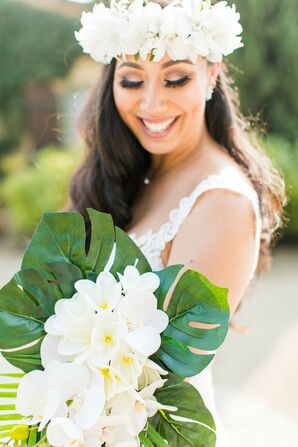 Bride Holding Tropical Bouquet with Plumeria and Monstera Leaves