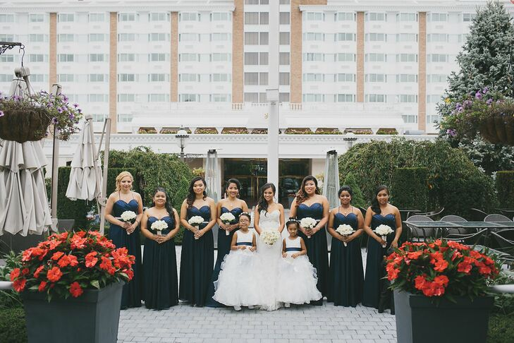127fa83021f Each of Rhea s bridesmaids wore a formal floor-length navy dress while the  maid of