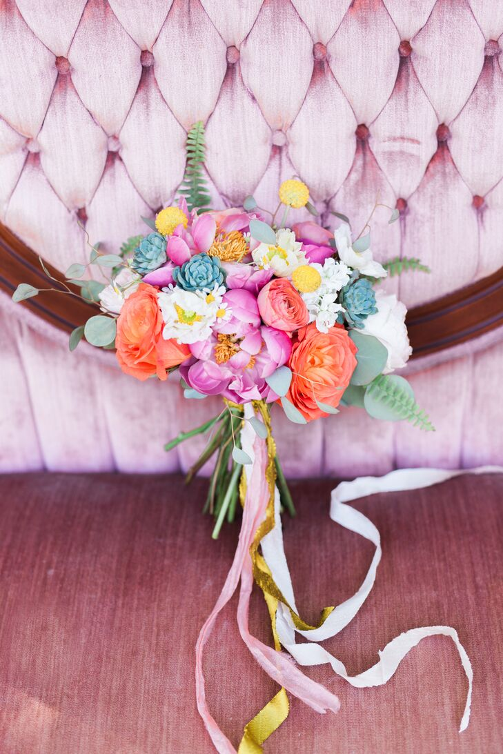 "Mandy of MJM Designs created the arrangements, bouquets and flower crowns for the big day. ""My only request was not to have any traditional roses,"" says Devin, who chose peonies, ranunculus and ferns. ""Mandy really came through on executing my vision of fun and colorful."""