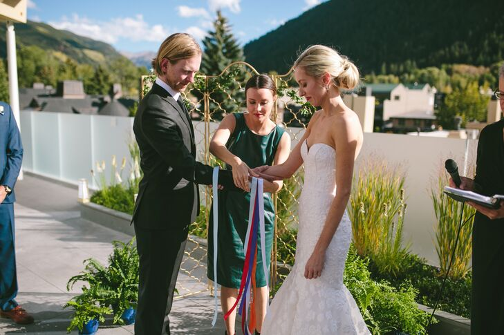 """Jessica and James opted for a Celtic hand-fasting ceremony to symbolize their bond—literally """"tying the knot"""" in front of friends and family at the Aspen Art Museum in Aspen, Colorado . The ribbons were wrapped around their hands in an ancient Celtic knot pattern, symbolizing their commitment to each other and acknowledging that their lives and their destinies are bound together."""