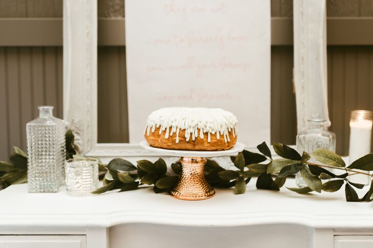 """Our wedding cake was a raspberry white chocolate bundt cake,"" the bride says, and guests were served a variety of mini bundt cakes called ""bundtinis""."