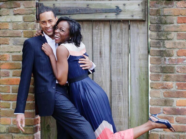Newly engaged couple hugging