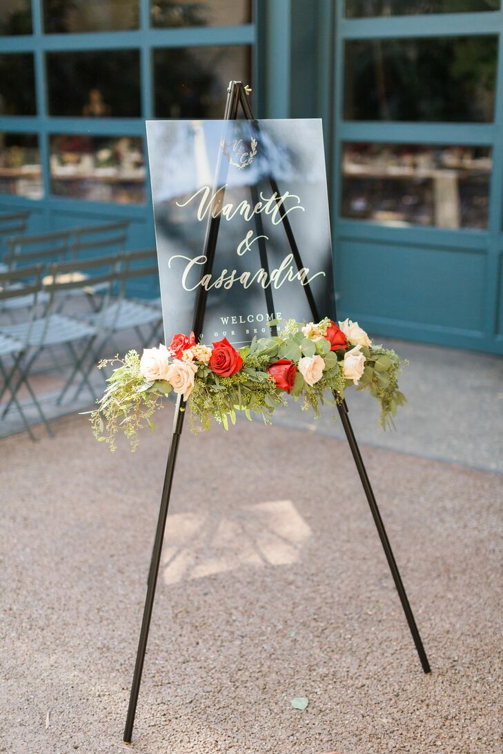Modern Welcome Sign on Easel with Flowers and Elegant Calligraphy