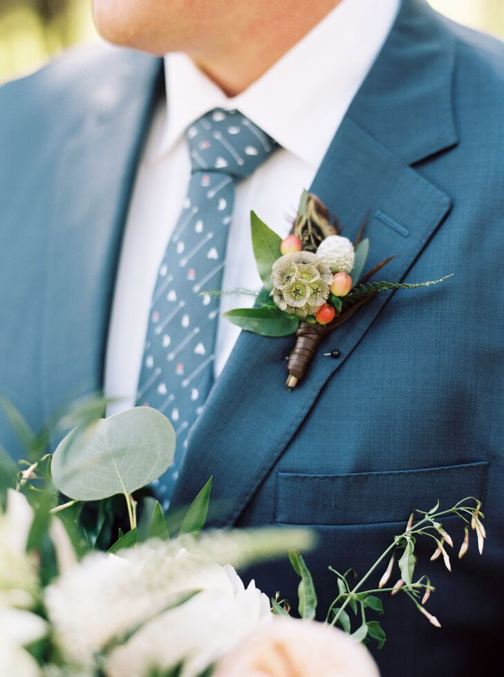 The groom's tie had tepees, arrows and campfires throughout the design. His boutonniere included a cord of leather.
