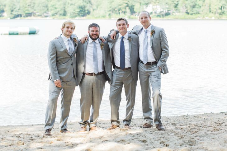 The groomsmen matched Mike's gray suit but donned light blue-gray ties.