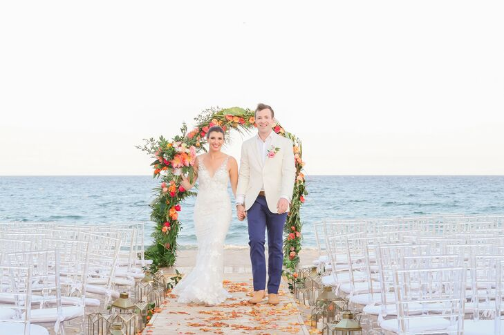 Kelsey White and Nick Heitz had a casual yet elegant wedding at Gulf Stream Bath and Tennis Club. A fun invitation suite introduced the wedding's trop