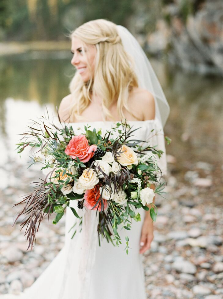 """My bouquet had a whimsical look with blush and ivory roses and lisianthus, accented with burgundy foliage, local Montana wildflowers, and sage greens,"" says Sarah, who relied on Habitat Floral Studio for all her blooms."