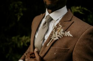 Groom in Brown Suit with Boutonniere of Dried Grasses