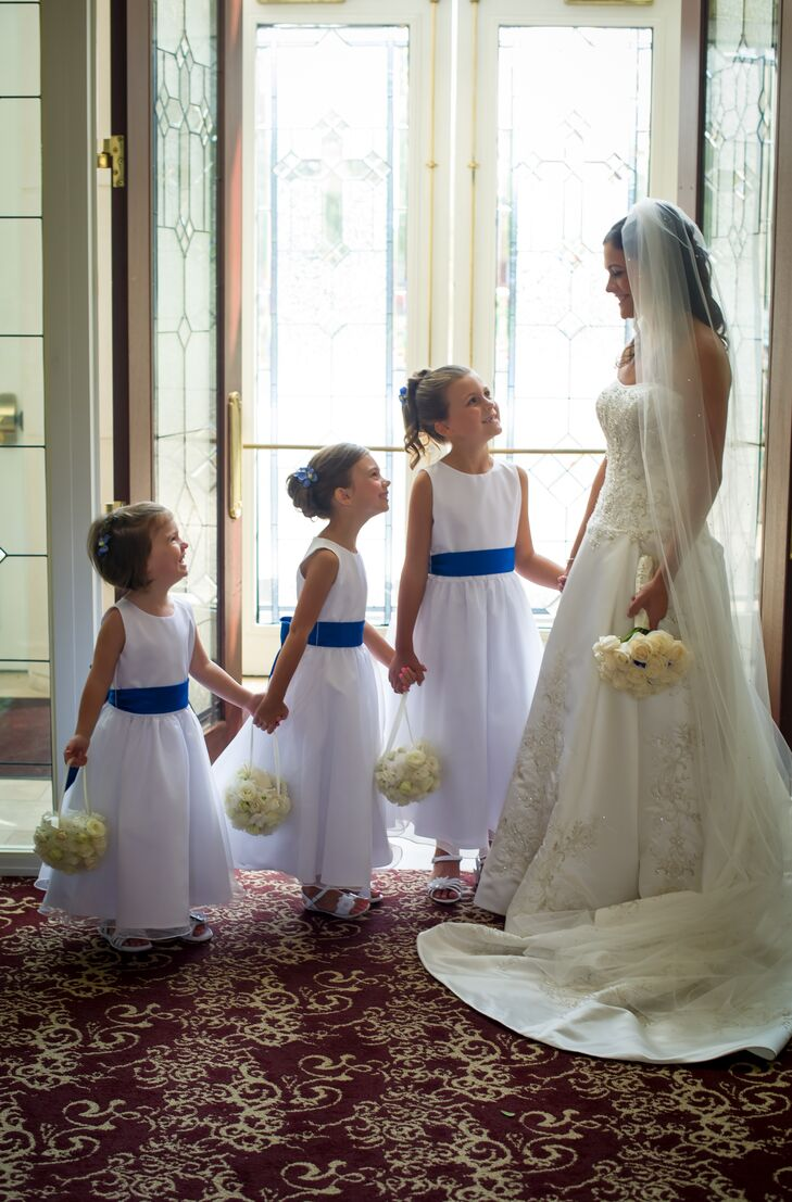 Matching Flower Girls with Navy Sash and Kissing Balls