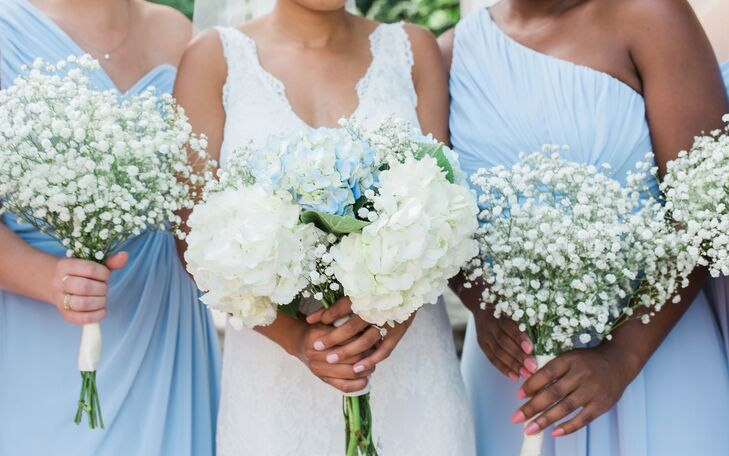Chelsea and Clay wanted all the details of the day to feel very Southern, to suit their North Carolina wedding location. They chose blue and white hydrangeas and white baby's breath for the bouquets to match the color palette and rustic theme.