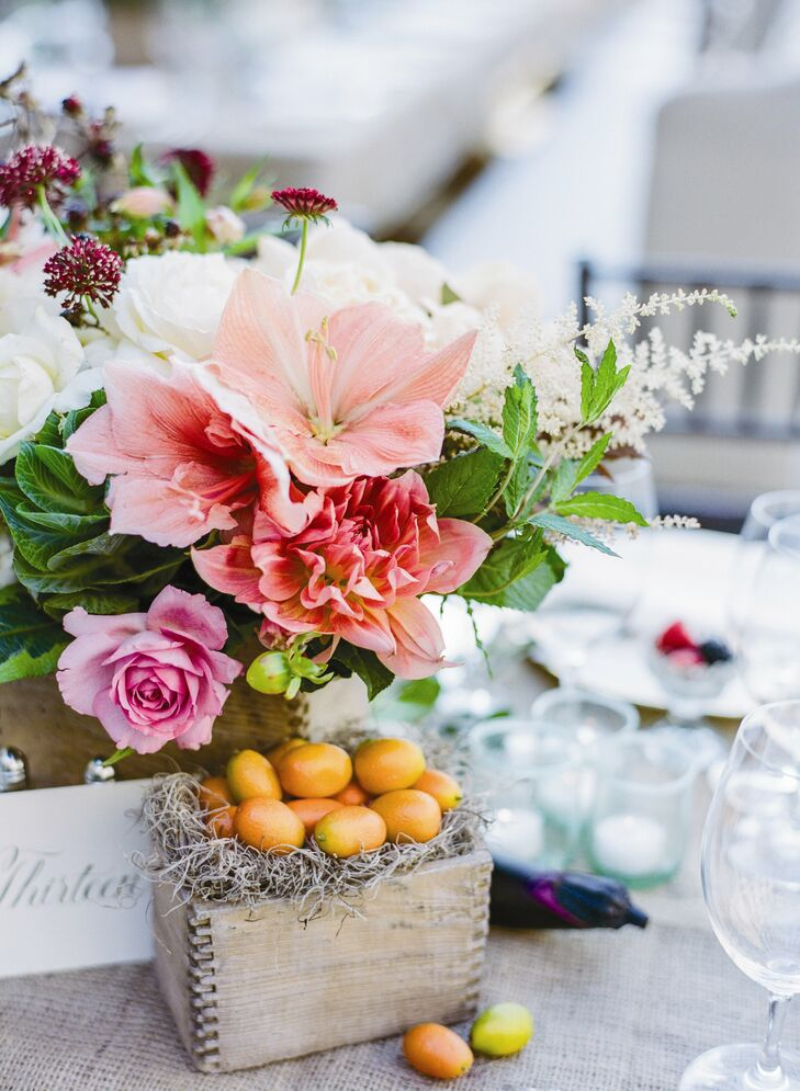 Rustic wood boxes filled with fresh fruits and vegetables added a bright pop of color to the tablescapes.