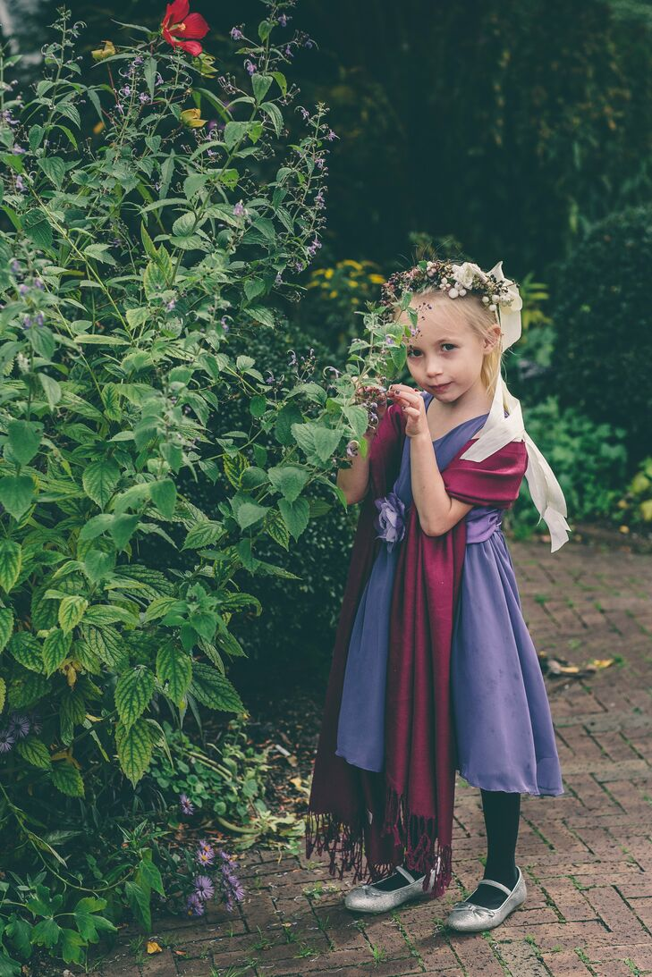 """The couple's flower girl wore a simple purple dress with a scarlet sash to match the wedding's colors and a flower crown made by the couple's florist. When she was asked later what her favorite part of the wedding was she said: """"when they kissed,"""" Anja recalls."""