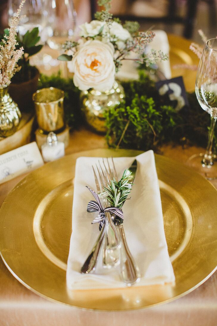 The silverware was tied with a striped ribbon with a spring of fresh greenery tucked within it.