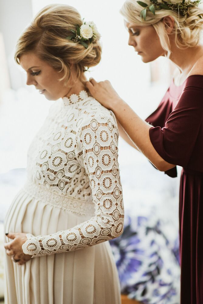 Laura wasn't pregnant with their second child when she ordered the dress; she was seven months pregnant when she got married. She was able to wear the gown with the help of her aunt's alterations, although she did have a backup gown just in case.