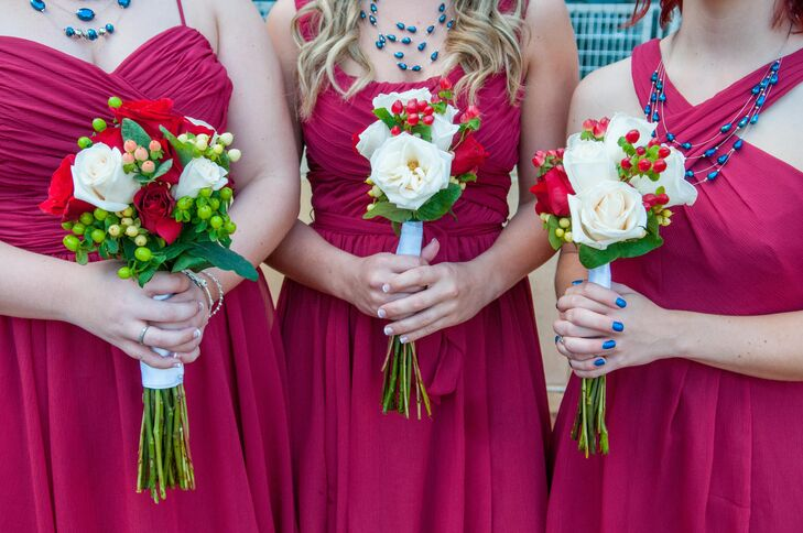 The bridesmaids carried small and simple white and red rose bouquets.