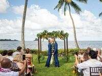 Grooms at beach wedding ceremony