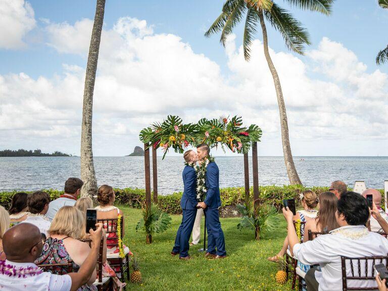Grooms at beach wedding ceremony