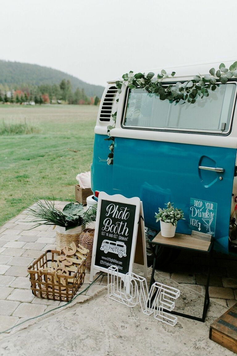 Blue VW bus with chalkboard sign and rustic decorations