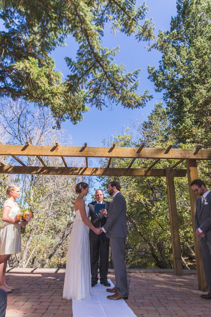 Abby and Ian exchanged vows on a secluded terrace surrounded by Aspen trees at the Pines at Genesee in Golden, Colorado.