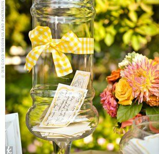 "Instead of a guest book, the couple asked for notes on ""the recipe for a happy marriage."" Guests dropped them in an apothecary jar dressed up with checkered ribbon."