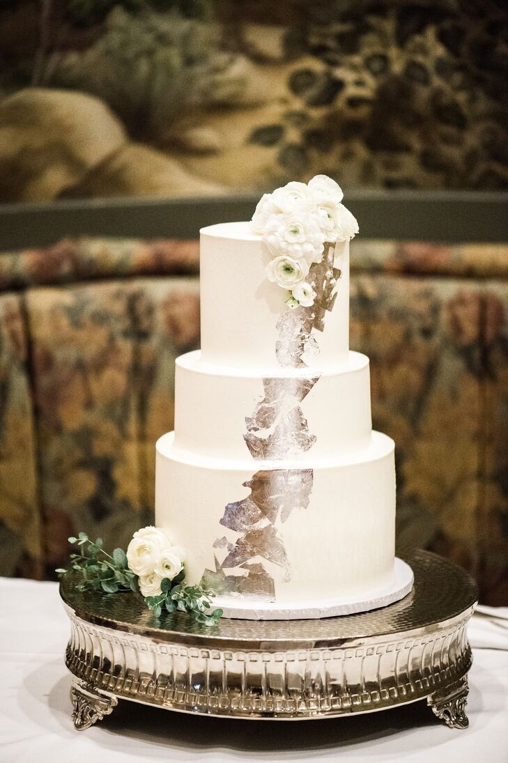 Local baker Sheila Mae designed Jon and Andrew's three-layer wedding cake with a cascade of edible silver leaf.