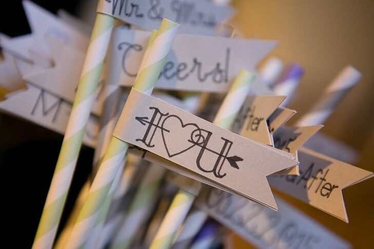 Among the many DIY touches to Mary and Joseph's wedding were flags on the cocktail straws. Small flags with romantic taglines were fastened to green- and white-striped straws.