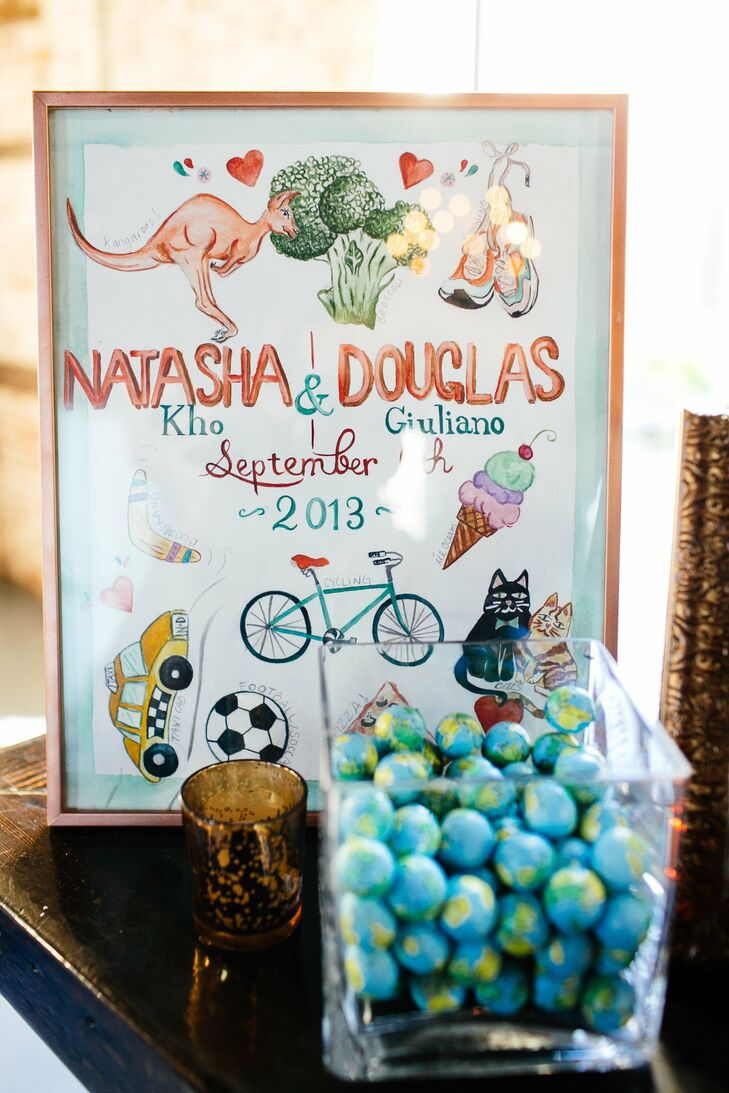 A fun, illustrated sign, highlighting some of the couple's interests, decorated the cocktail bar.